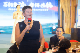 Kathryn Read speaking at an event in China